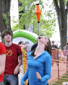 "Emma Gotter (Rosaline in ""Romeo & Juliet"") shows off her balancing skills as Dan Stromquist (Balthasar in ""Romeo & Juliet"") watches during the Taste of Wheaton."