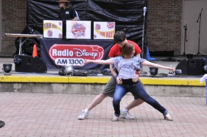 "John Trygstad (Abraham) and Katheryn Pucillo (Gloria in ""Romeo & Juliet"") participate in the R&J flashmob at the Taste of Wheaton."