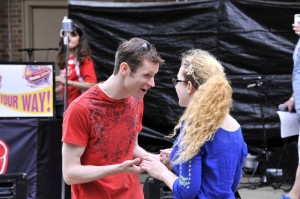 Garrett Ard (Romeo) and Nikki Wilson (Juliet) perform the titular characters' meeting during the R&J flashmob at the Taste of Wheaton.