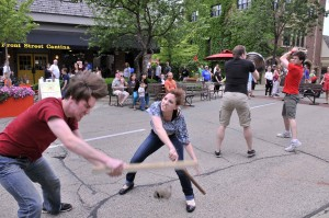 "Dan Stromquist and Katheryn Pucillo demonstrate a section of the Montague/Capulet fight from ""Romeo & Juliet"" outside Playhouse 111 at the Taste of Wheaton."