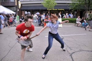 "John Trygstad and Katheryn Pucillo of ""Romeo & Juliet"" fight for the Taste of Wheaton crowd."
