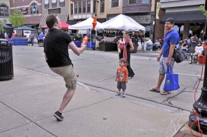 "Andrew Trygstad (Mercutio in ""Romeo & Juliet"") juggles for Taste of Wheaton visitors."